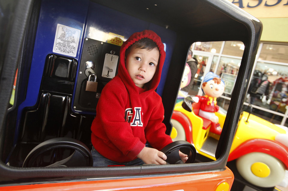 Logan Lucas, 3 from Yukon, steers a mechanical ride while shopping with his grandmother at The Outlet Shoppes of Oklahoma City in Oklahoma City Friday, Dec, 23, 2011. Photo by Paul B. Southerland, The Oklahoman