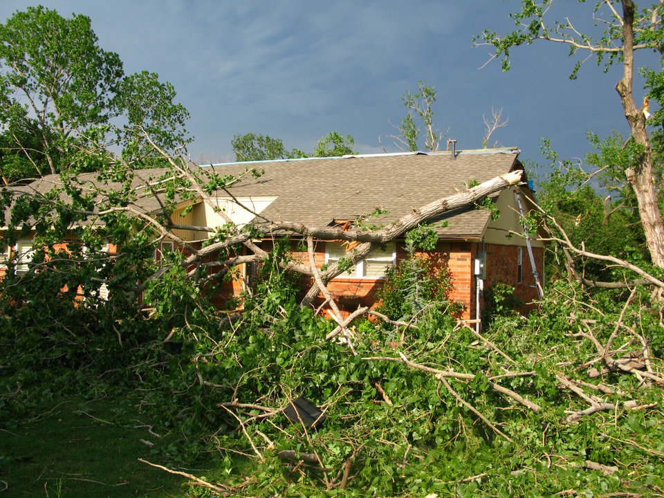 A tree hit the home of Reggie and Trish Ayers in the Hidden Valley addition in southeast Edmond. Photo by Lillie-Beth Brinkman, The Oklahoman
