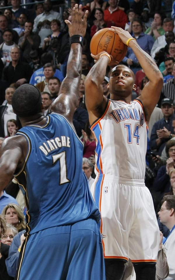 Oklahoma City\'s Daequan Cook (14) shoots over Andray Blatche (7) of Washington during the NBA basketball game between the Washington Wizards and the Oklahoma City Thunder at the Oklahoma City Arena in Oklahoma City, Friday, January 28, 2011. The Thunder won, 124-117, in double overtime. Photo by Nate Billings, The Oklahoman