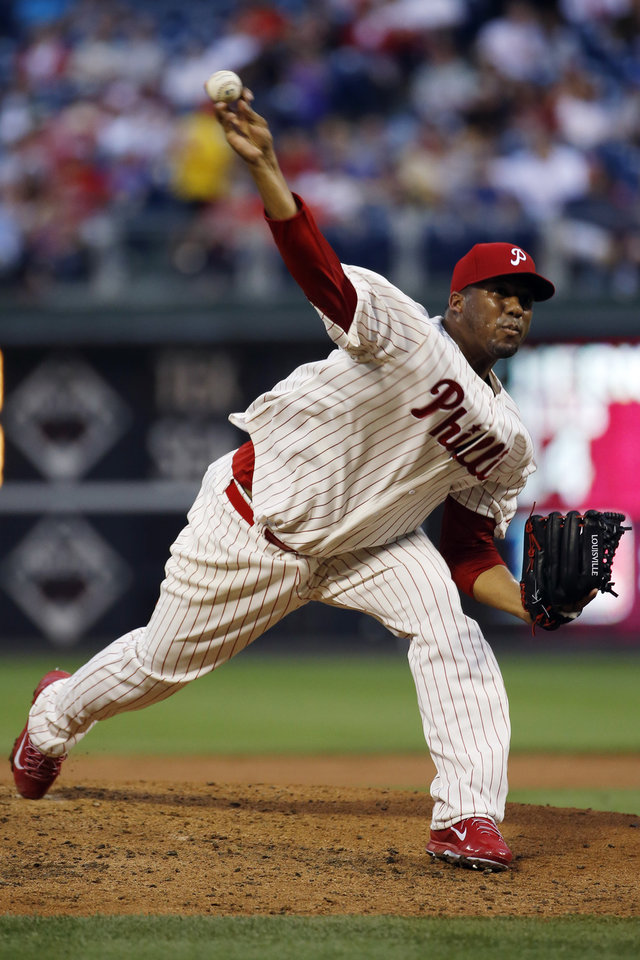 Photo - Philadelphia Phillies' Roberto Hernandez pitches during the third inning of a baseball game against the Chicago Cubs, Friday, June 13, 2014, in Philadelphia. (AP Photo/Matt Slocum)