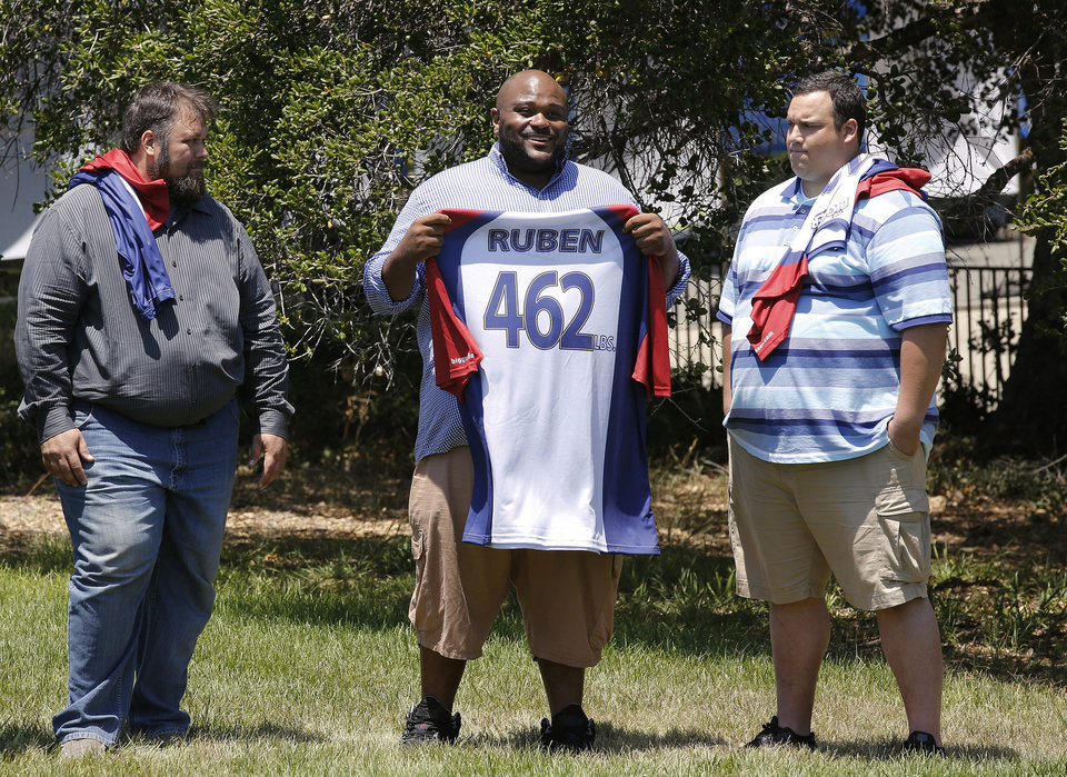 This image released by NBC shows, from left, David Brown, Ruben Studdard, and Hap Holmstead on
