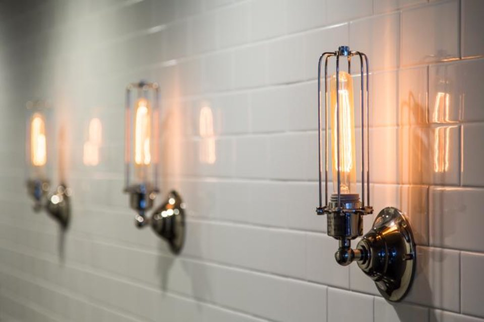 Photo -  The decor at Urban Johnnie features vintage-looking light fixtures and subway tile.    Randy Alvarado