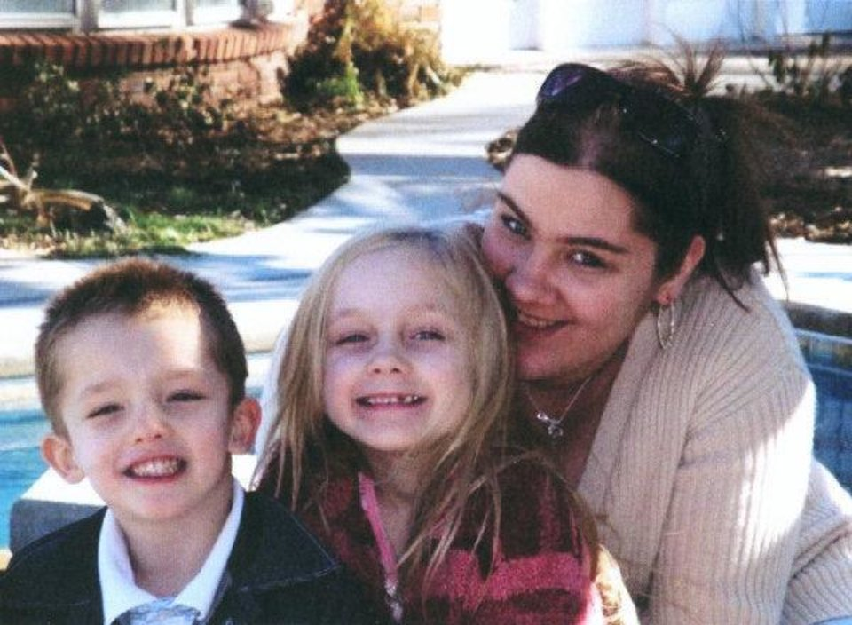 Photo - Jordan Morris, Alexis Morris and their mother, Christina Potter, posed for this photo around Christmas 2008. Alexis was 6 years old when she died.  PROVIDED - Photo provided