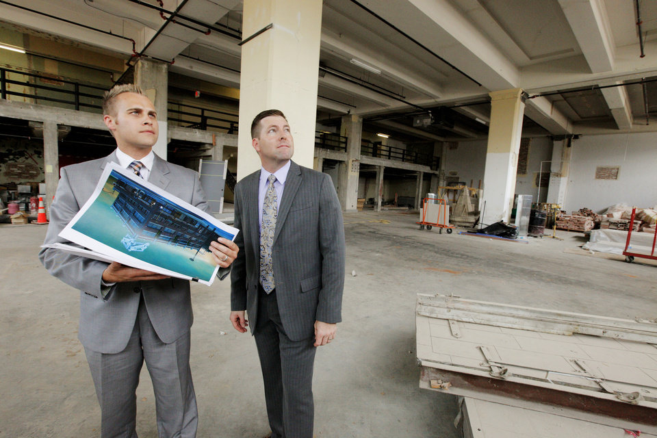 Photo -  Jeff Dixon and Aaron Soward, partners in Provision Concepts, discuss their restaurant plans inside the Buick Building at 1101 N Broadway Ave.    PAUL B. SOUTHERLAND -  PAUL B. SOUTHERLAND