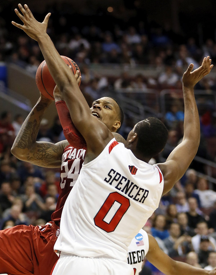 Oklahoma\'s Romero Osby (24) moves to the hoop against Skylar Spencer (0) during a game between the University of Oklahoma and San Diego State in the second round of the NCAA men\'s college basketball tournament at the Wells Fargo Center in Philadelphia, Friday, March 22, 2013. Photo by Nate Billings, The Oklahoman