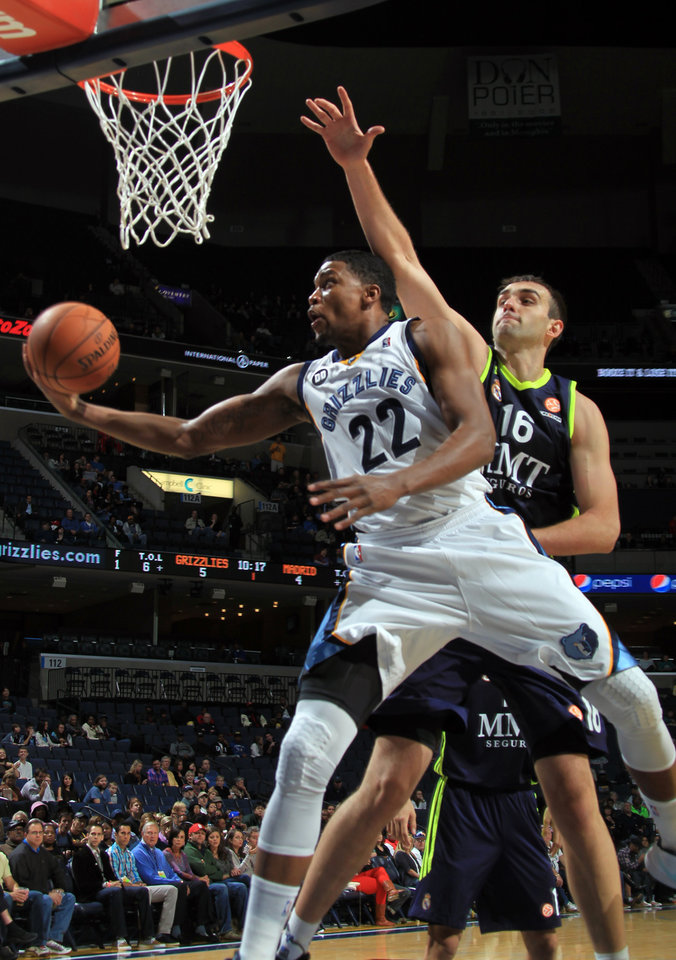 Memphis Grizzlies forward Rudy Gay (22) shoots while defended by Real Madrid center Mirza Begic (16) in the first half of an NBA basketball preseason game on Saturday, Oct. 6, 2012, in Memphis, Tenn. (AP Photo/Nikki Boertman)