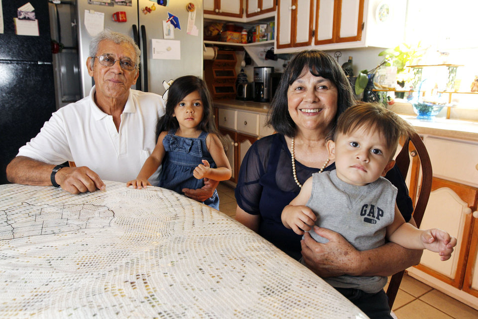Photo - Elsa Garcia, a Latina breast cancer survivor, along with her husband, Roberto and grandchildren Yori, 4, and Ethan, 1, sit at the breakfast table at their home in Oklahoma City, OK, Friday, June 21, 2013,  Photo by Paul Hellstern, The Oklahoman