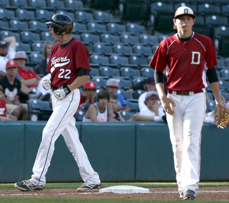Photo - Tuttle's  Zac Wall celebrates as Dewey's Nic Barnett reacts during the class 4A state baseball championship game between Tuttle and Dewey at the Chickasaw Bricktown Ballpark in Oklahoma City, Saturday, May 17, 2014. Photo by Sarah Phipps, The Oklahoman