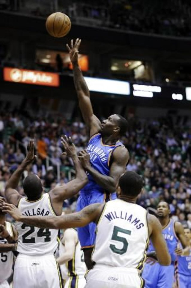 Oklahoma City Thunder\'s Kendrick Perkins, center, shoots as Utah Jazz\'s Paul Millsap (24) and Mo Williams (5) watch in the first quarter during an NBA basketball game, Tuesday, April 9, 2013, in Salt Lake City. (AP file)