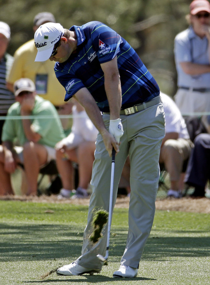 Photo - Marc Leishman, of Australia, hits off the first fairway during the first round of the Masters golf tournament Thursday, April 10, 2014, in Augusta, Ga. (AP Photo/Darron Cummings)