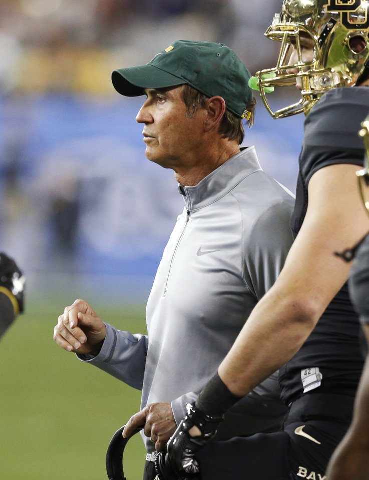 Photo - Baylor coach Art Briles talks with his team during the first half of the Fiesta Bowl NCAA college football game against Central Flordia, Wednesday, Jan. 1, 2014, in Glendale, Ariz.  (AP Photo/Ross D. Franklin)