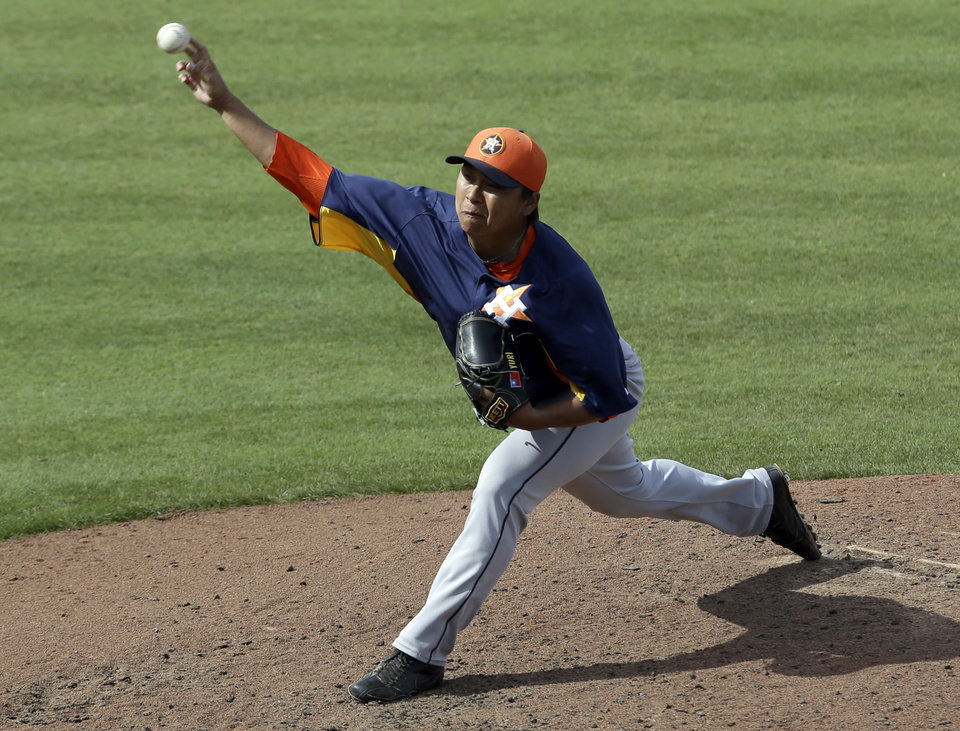 Houston Astros relief pitcher Chia-Jen Lo, of Taiwan, throws during the fifth inning of a spring training baseball game against the New York Mets on Saturday, March 9, 2013, in Port St. Lucie, Fla. (AP Photo/Jeff Roberson)
