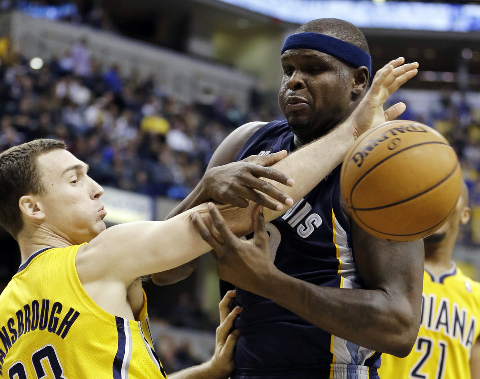 Indiana Pacers\' Ben Hansbrough (23) and Memphis Grizzlies\' Zach Randolph (50) battle for a rebound during the second half of an NBA basketball game, Monday, Dec. 31, 2012, in Indianapolis. Indiana won 88-83. (AP Photo/Darron Cummings)