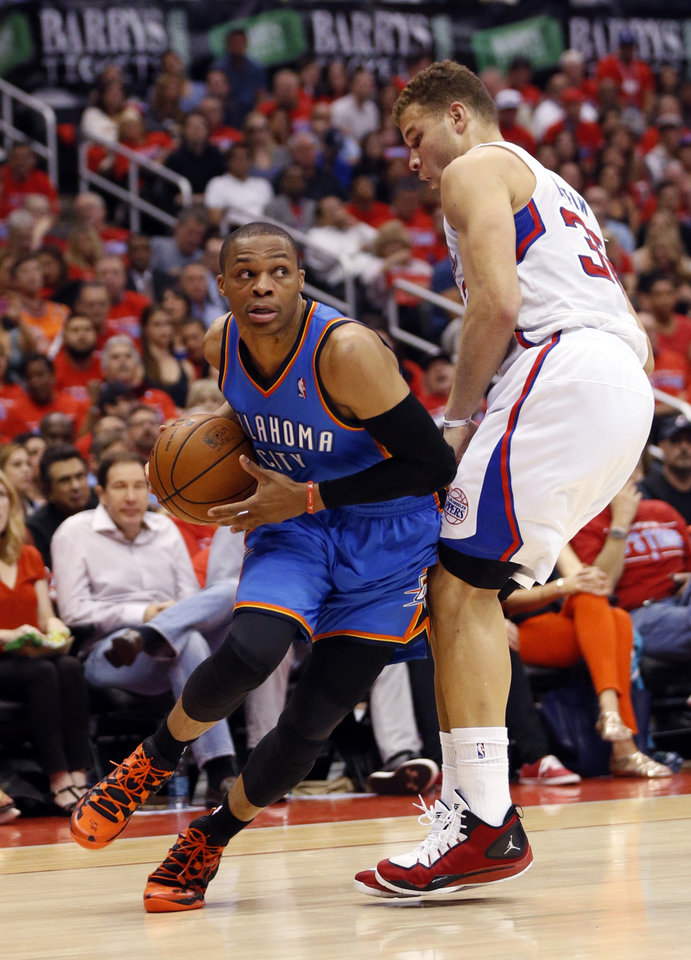 Photo - Oklahoma City's Russell Westbrook (0) tries to get around Los Angeles' Blake Griffin (32) during Game 6 of the Western Conference semifinals in the NBA playoffs between the Oklahoma City Thunder and the Los Angeles Clippers at the Staples Center in Los Angeles, Thursday, May 15, 2014. Photo by Nate Billings, The Oklahoman