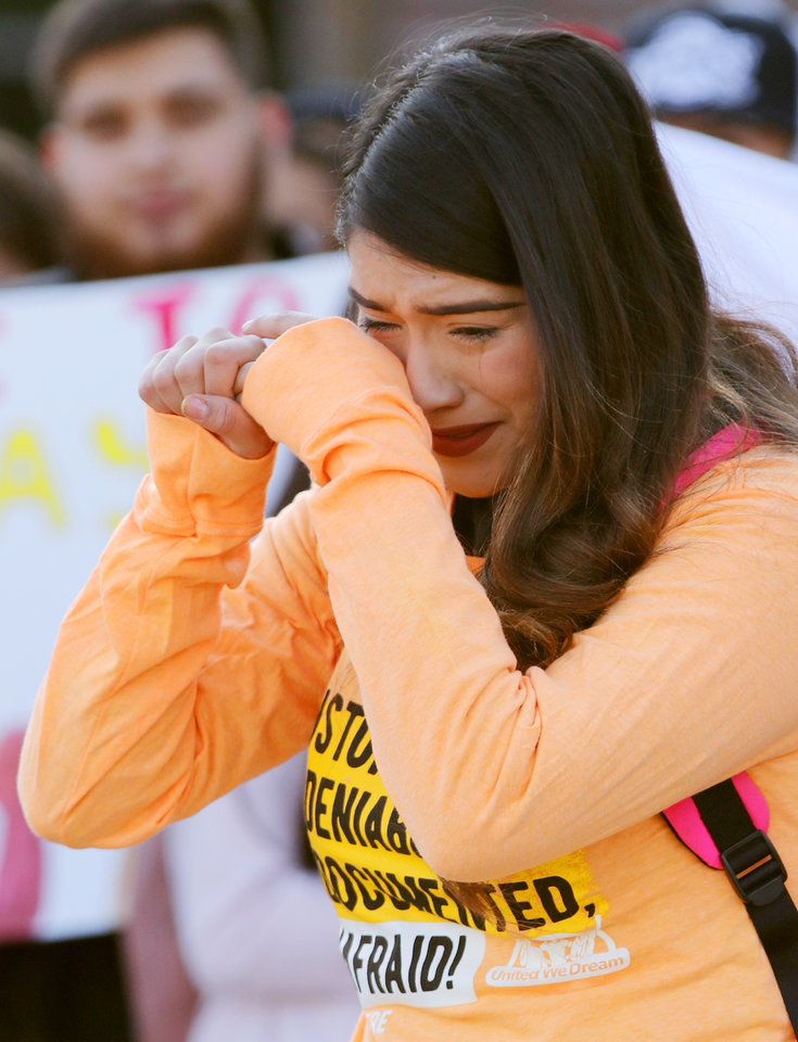 Photo - Wendy Rizera gets emotional while speaking to the group during the DACA sign at the DACA support rally at U.S. Grant High School Friday, November 8, 2019. Photo by Doug Hoke