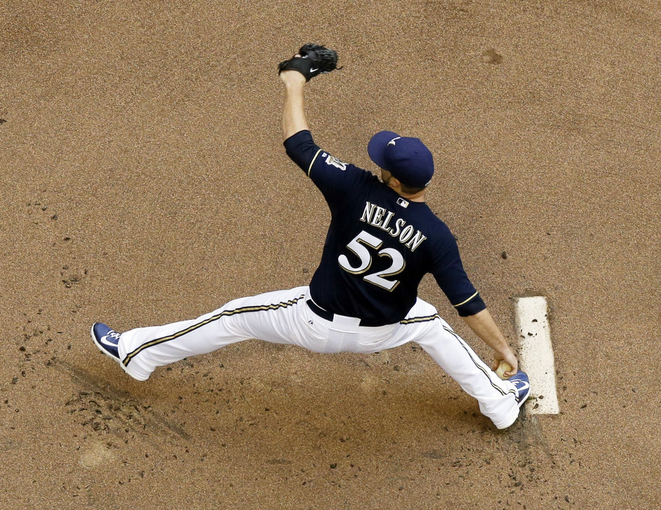 Photo - Milwaukee Brewers starting pitcher Jimmy Nelson throws during the first inning of a baseball game against the Toronto Blue Jays Wednesday, Aug. 20, 2014, in Milwaukee. (AP Photo/Morry Gash)
