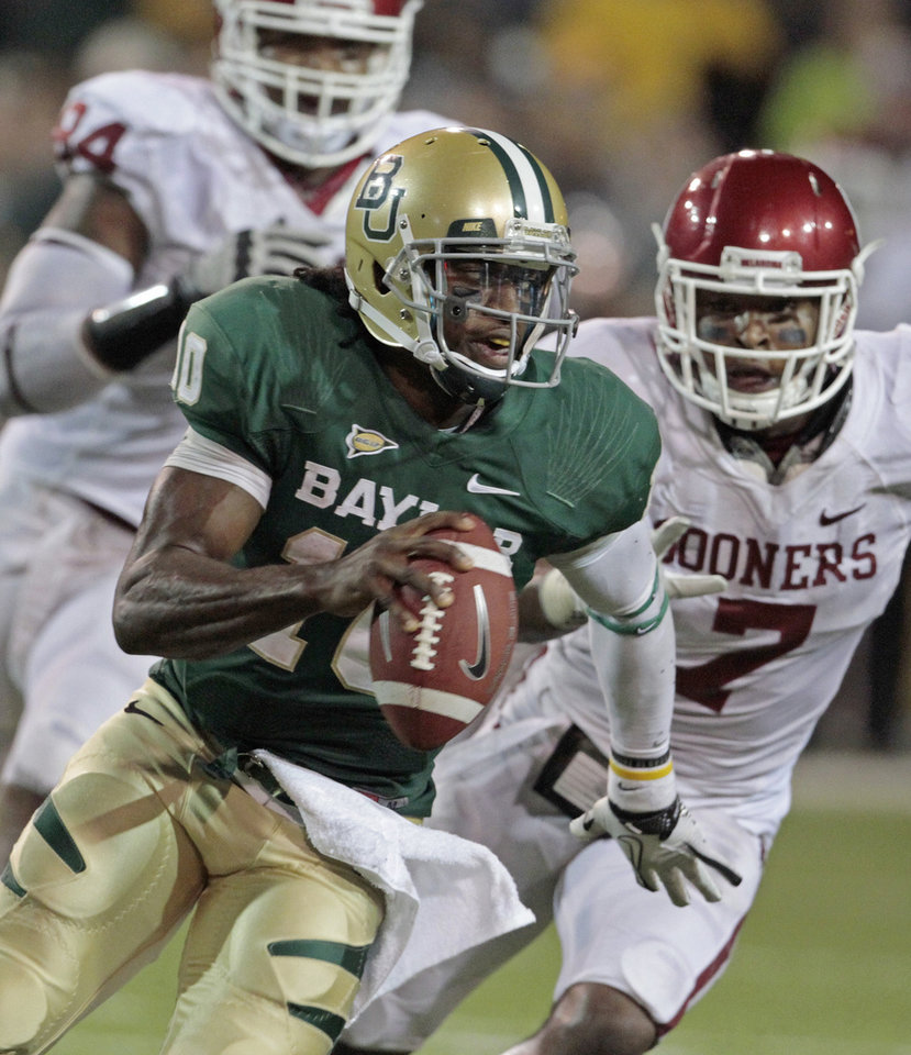 Oklahoma's Frank Alexander (84) and Corey Nelson (7) chase Baylor's Robert Griffin III (10) during the second half of the college football game in which the University of Oklahoma Sooners (OU) was defeated 45-38 by the Baylor Bears (BU) at Floyd Casey Stadium on Saturday, Nov. 19, 2011, in Waco, Texas.   Photo by Steve Sisney, The Oklahoman ORG XMIT: KOD