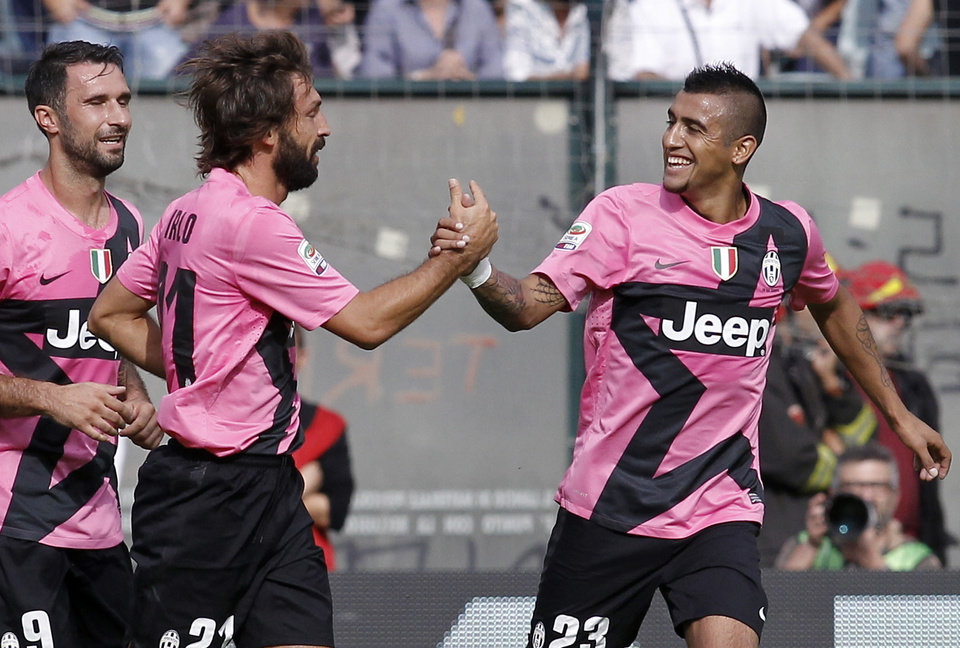 Photo -   Juventus player Andrea Pirlo, second from right, celebrates with his teammate Arturo Vidal, of chile, after scoring during an Italian Serie A soccer match between Siena and Juventus, in Siena , Italy, Oct. 7, 2012. (AP Photo/Paolo Lazzeroni)