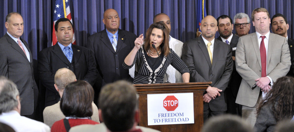 Senate Minority leader Gretchen Whitmer, D-East Lansing, speaks to supporters Wednesday afternoon, Dec. 5, 2012 at the Capitol in Lansing, Mich., as House and Senate Democrats hold a news conference to speak on the possibility of