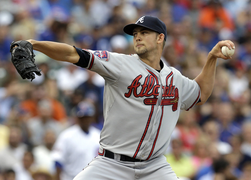 Photo - Atlanta Braves starter Mike Minor throws against the Chicago Cubs during the first inning of a baseball game in Chicago, Saturday, July 12, 2014. (AP Photo/Nam Y. Huh)