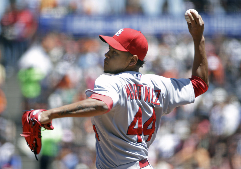 Photo - St. Louis Cardinals starting pitcher Carlos Martinez throws in the first inning of their baseball game against the San Francisco Giants Thursday, July 3, 2014, in San Francisco. (AP Photo/Eric Risberg)