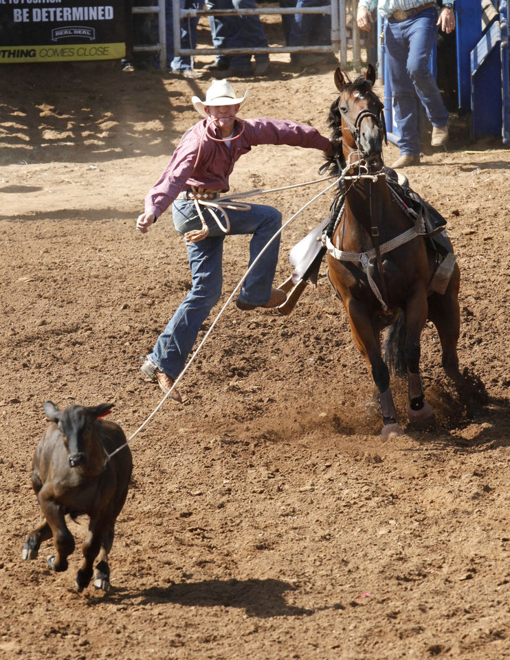 Photo - Jack Urbanek, from Stratford, OK, competes in the calf roping event during Tuesday's performances at the International Youth Finals Rodeo at the Shawnee Heart of Oklahoma Exposition Center in Shawnee, OK, Tuesday, July 8, 2014,  Photo by Paul Hellstern, The Oklahoman