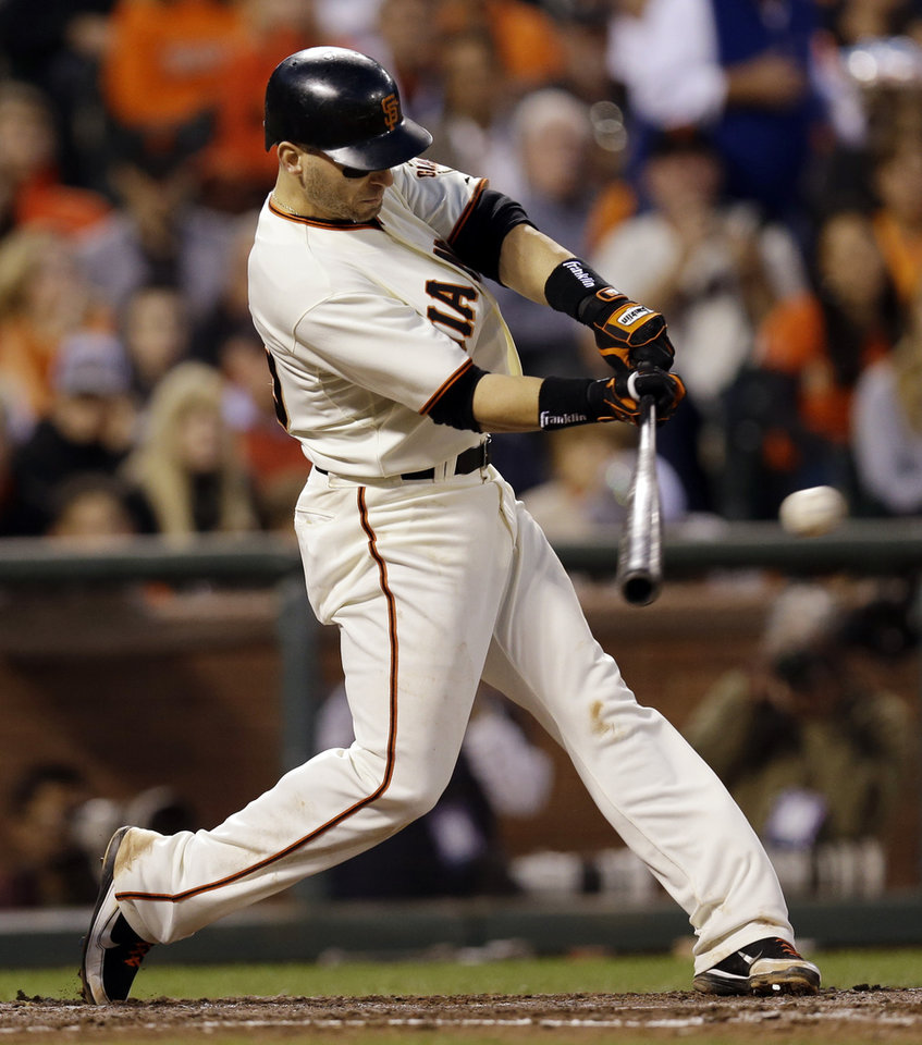 Photo -   San Francisco Giants' Marco Scutaro hits a three-run hit during the fourth inning of Game 2 of baseball's National League championship series against the St. Louis Cardinals Monday, Oct. 15, 2012, in San Francisco. (AP Photo/David J. Phillip)