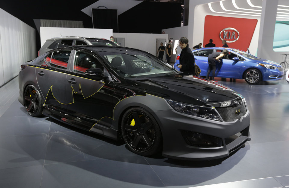 "The Batman-decorated Kia Optima is displayed at the North American International Auto Show in Detroit, Tuesday, Jan. 15, 2013. The comic inspired auto at the South Korean automaker's exhibit was created to promote an effort to fight hunger in Africa. Features include Batman symbols inside and outside on the Optima and was created as part of a partnership involving DC Entertainment. The ""We Can Be Heroes"" effort is promoted in part by the use of Justice League characters. (AP Photo/Carlos Osorio)"