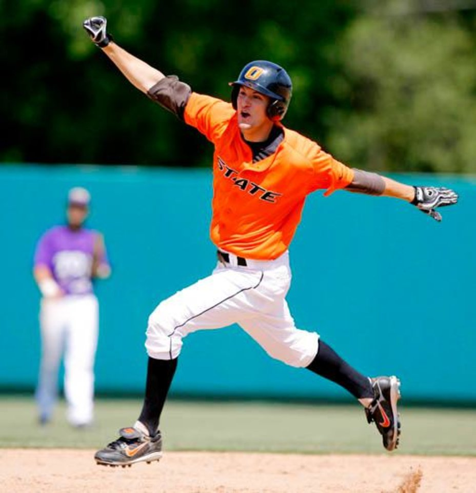 Photo -  OSU's Jordy Mercer celebrates as he runs around the bases following his game-winning solo home run in the ninth inning during the NCAA Stillwater Regional baseball game between Oklahoma State University and Texas Christian University at Allie P. Reynolds Stadium in Stillwater, Okla., Sunday, June 1, 2008. OSU won 9-8. BY MATT STRASEN, THE OKLAHOMAN
