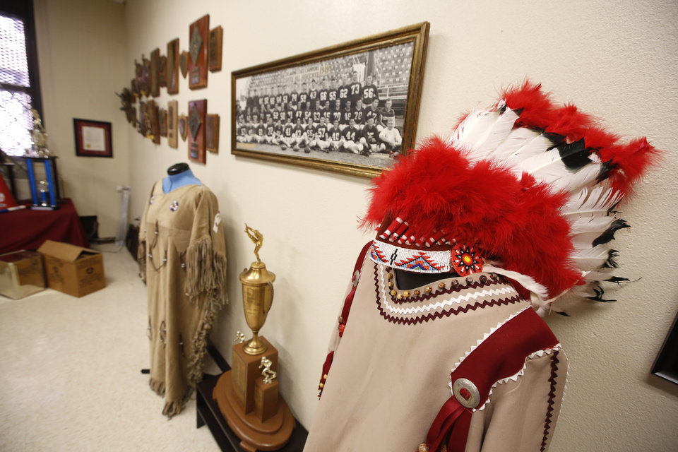 Photo -  Right: Memorabilia line the walls of the alumni room of Capitol Hill High School in Oklahoma City.  Photos By Steve Gooch, The Oklahoman   Steve Gooch -