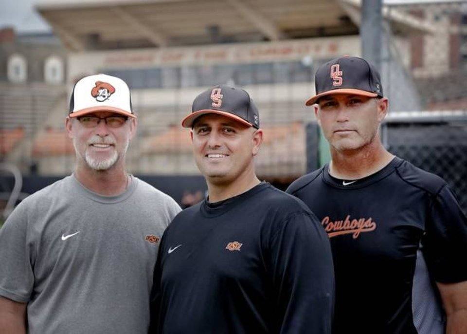 Photo -  Oklahoma State baseball coaches Rob Walton, Josh Holliday and Marty Lees, from left, pose for a photo before the team leaves for its regional in Louisville on Tuesday, May 28, 2013 in Stillwater, Okla. Photo by Chris Landsberger, The Oklahoman.