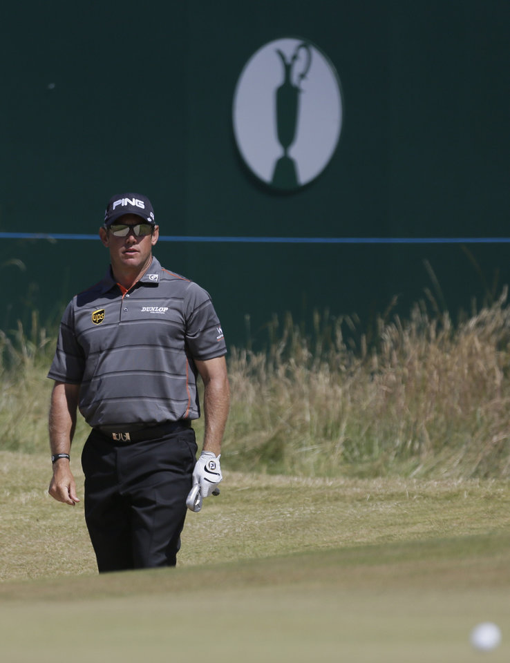 Photo - Lee Westwood of England looks at his ball on the 18th green after playing out of a bunker during the second round of the British Open Golf Championship at Muirfield, Scotland, Friday July 19, 2013. (AP Photo/Jon Super)