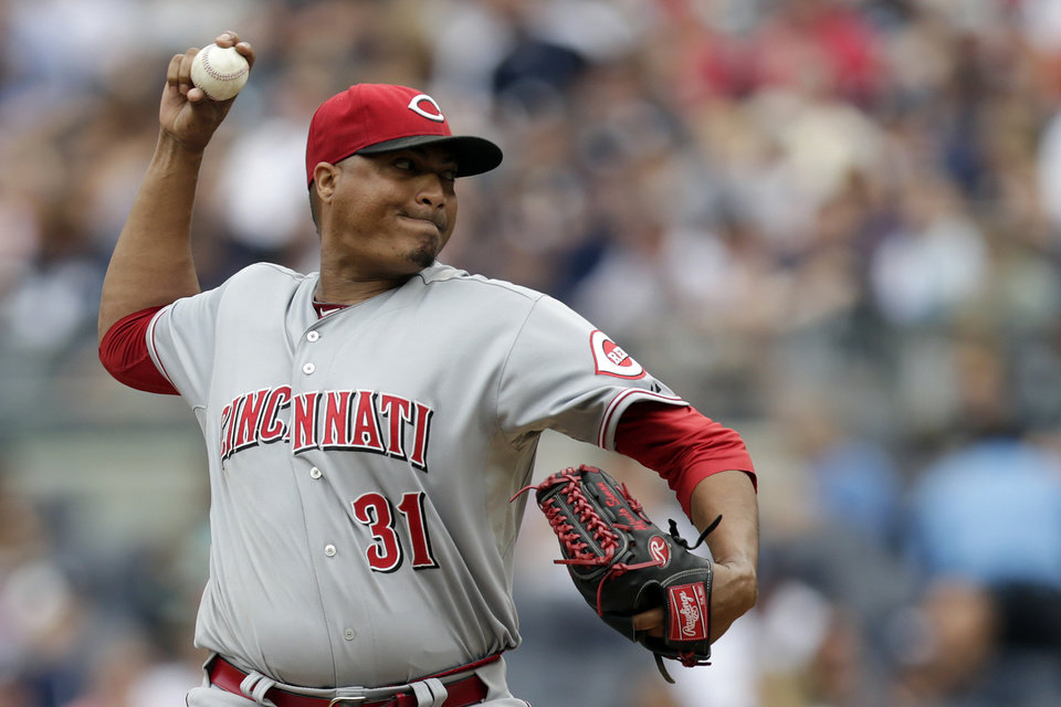 Photo - Cincinnati Reds starting pitcher Alfredo Simon throws a pitch to the New York Yankees during the first inning of an MLB baseball game, Saturday, July 19, 2014, at Yankee Stadium in New York. (AP Photo/Julio Cortez)
