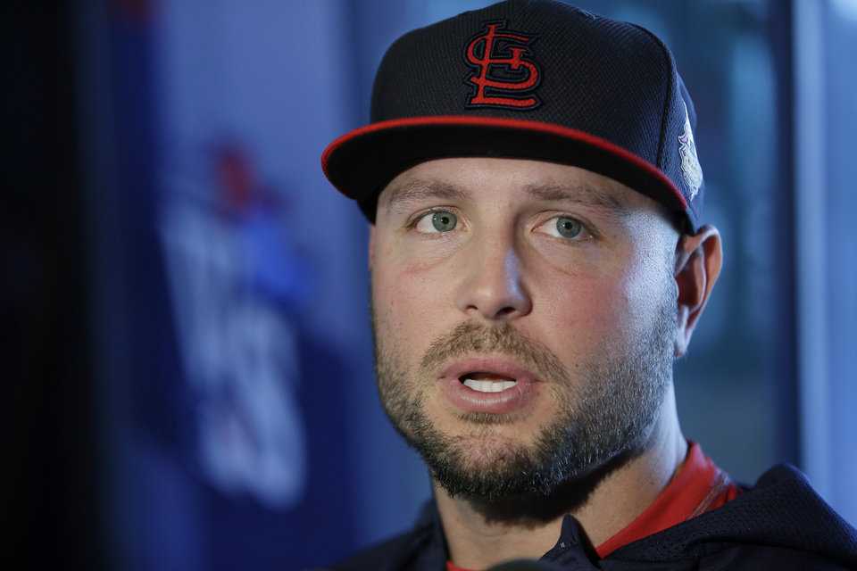Photo - File-This Oct. 22, 2013, file photo shows St. Louis Cardinals' Matt Holliday answering questions during a media availability for Game 1 of baseball's World Series against the Boston Red Sox in Boston. Holliday has been an outspoken critic of players who have used performance-enhancing drugs. When it comes to Jhonny Peralta, his new St. Louis Cardinals teammate, he is willing to forgive and forget.  (AP Photo/Matt Slocum, File)