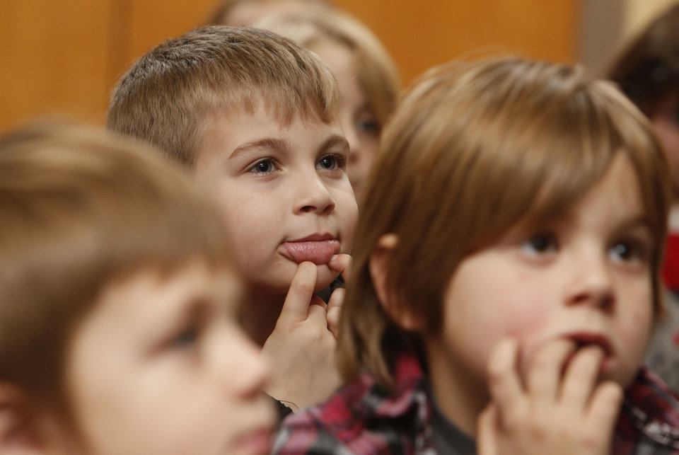 Jadon Kent, 6, makes a face as he listens to a story during the after-school special story time Thursday at the Norman Public Library. PHOTO BY STEVE SISNEY, THE OKLAHOMAN <strong>STEVE SISNEY</strong>