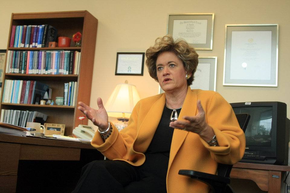 Photo - FILE - In this Dec. 22, 2008 New Travis County District Attorney Rosemary Lehmberg speaks during an interview in her Austin, Texas, office. A Travis County grand jury on Friday, Aug. 15, 2014 indicted Texas Gov. Rick Perry for carrying out a threat to veto state funds to Lehmberg, an elected Democrat, unless she resigned following her arrest and conviction for drunken driving. That 2013 veto prompted a criminal investigation. (AP Photo/Jack Plunkett, File)