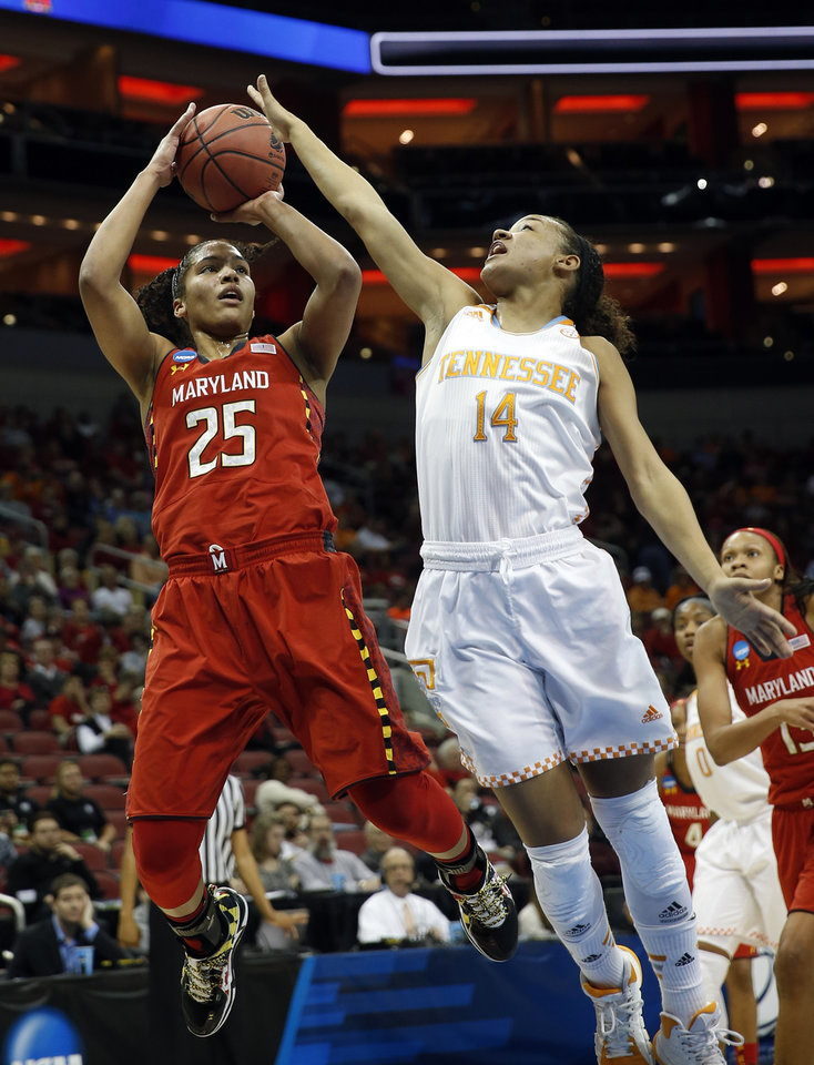 Photo - Maryland forward Alyssa Thomas (25) goes up to shoot against Tennessee guard Andraya Carter (14) during the first half of a regional semifinal game at the NCAA college basketball tournament on Sunday, March 30, 2014, in Louisville, Ky. (AP Photo/John Bazemore)
