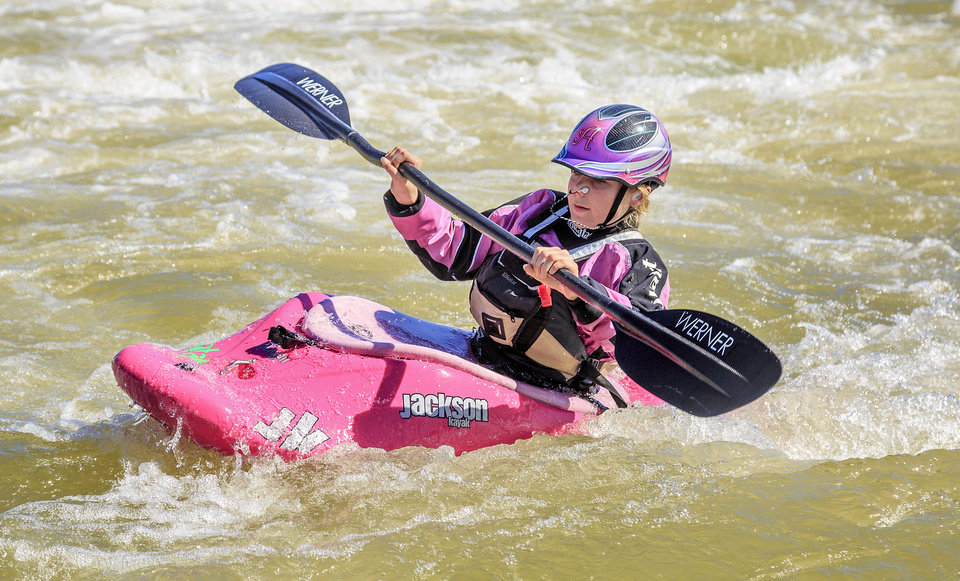 Photo - Abby Holcombe, 12, navigates the rapids  during a kayak adventure with her parents Peter and Kathy at the Riversport Rapids in Oklahoma City, Okla., Friday, Oct. 21, 2016. Peter and Kathy decided two years ago to sale their home in Boulder, Colo., to live on the road with their daughter Abby kayaking, hiking and rock-climb across America.  Photo by Chris Landsberger, The Oklahoman