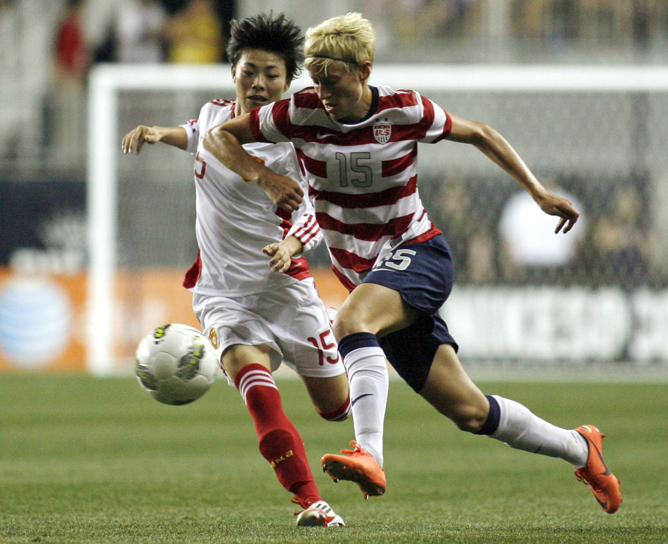 Photo -   United States' Megan Rapinoe (15) and China's Xu Yanlu (15) fight for ball control during the second half of their international friendly soccer match in Chester, Pa., Sunday, May 27, 2012. United States won 4-1. (AP Photo/H. Rumph Jr.)