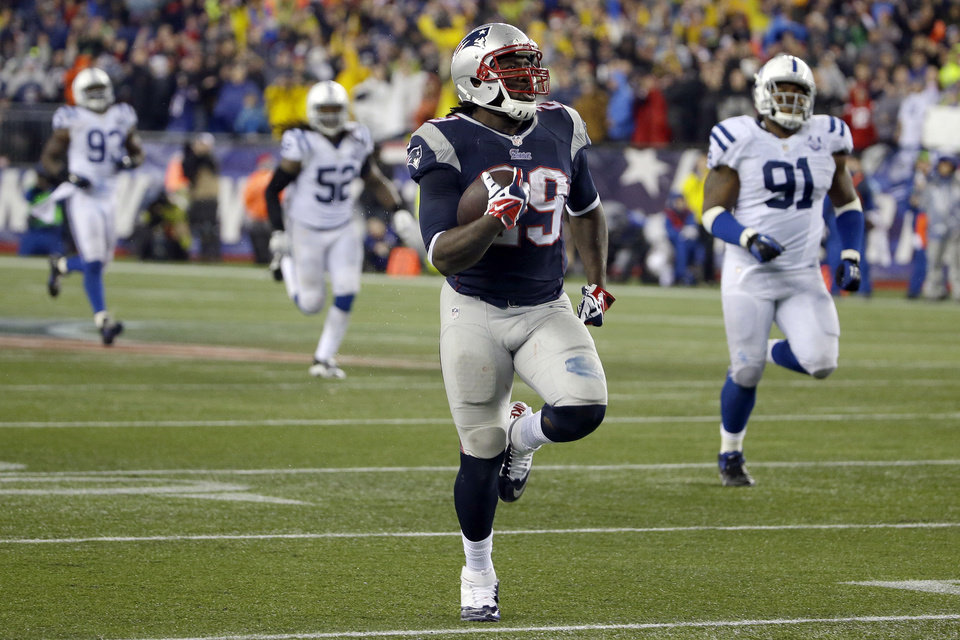 Photo - New England Patriots running back LeGarrette Blount (29) heads down field for a 75 yard touchdown run during the second half of an AFC divisional NFL playoff football game against the Indianapolis Colts in Foxborough, Mass., Saturday, Jan. 11, 2014. (AP Photo/Matt Slocum)