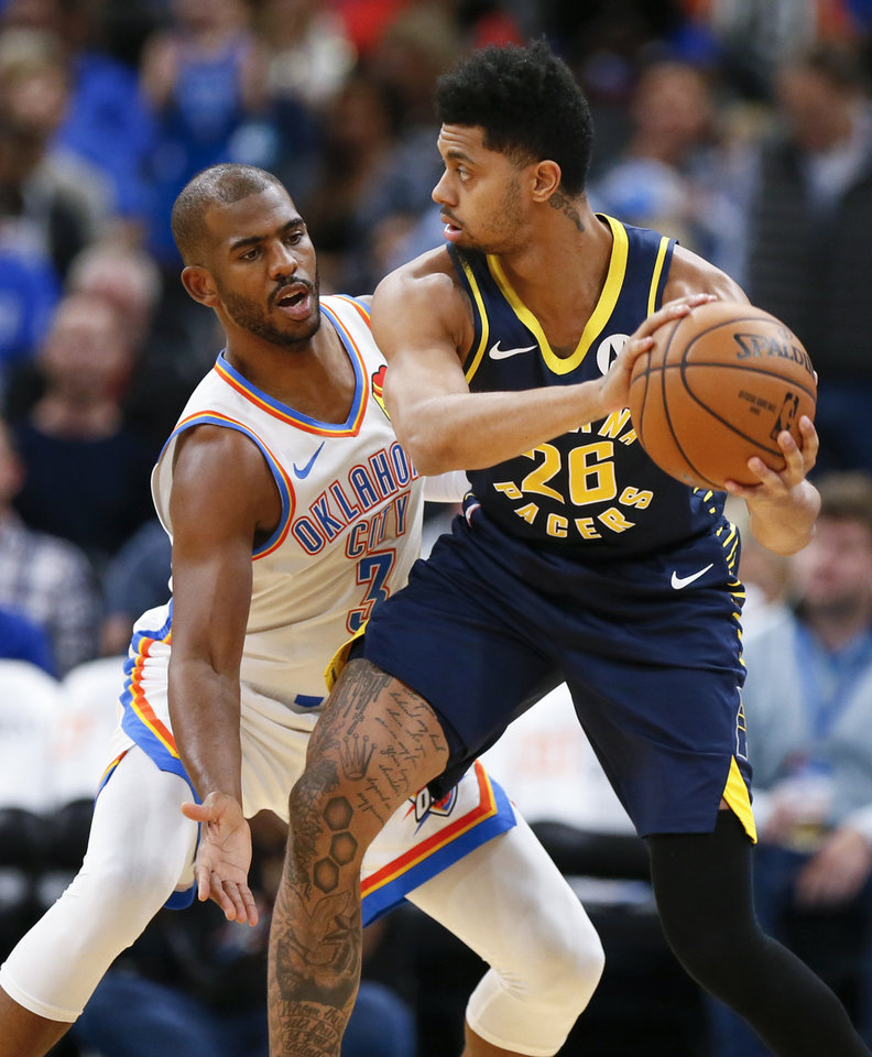 Photo - Oklahoma City's Chris Paul (3) defends Indiana's Jeremy Lamb (26) in the first quarter during an NBA basketball game between the Indiana Pacers and the Oklahoma City Thunder at Chesapeake Energy Arena in Oklahoma City, Wednesday, Dec. 4, 2019. [Nate Billings/The Oklahoman]