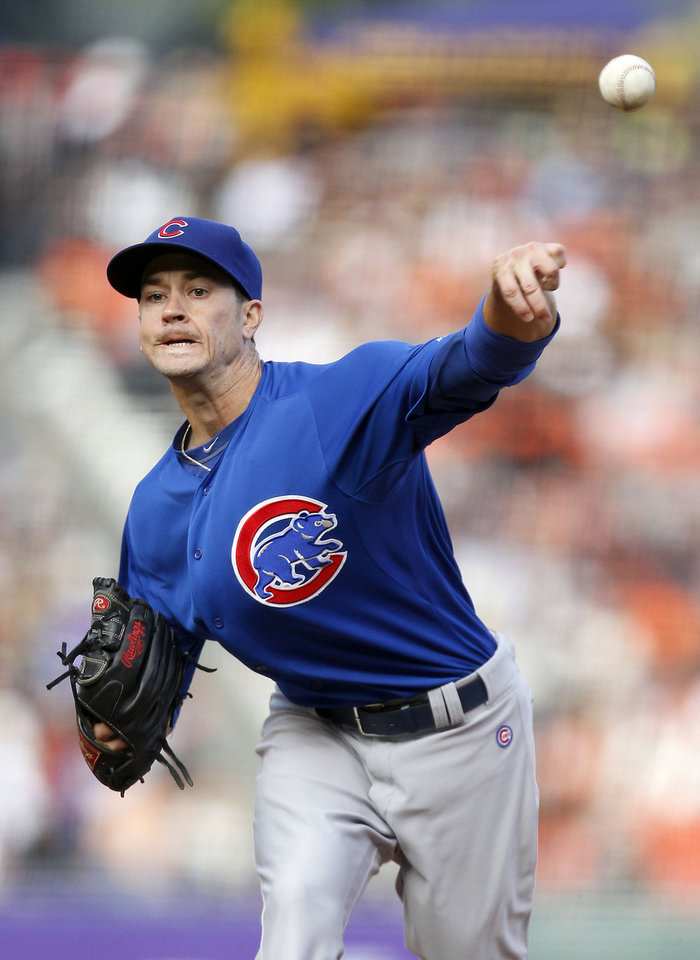 Photo - Chicago Cubs starting pitcher Chris Rusin throws to the San Francisco Giants during the first inning of a baseball game on Saturday, July 27, 2013, in San Francisco. (AP Photo/Tony Avelar)