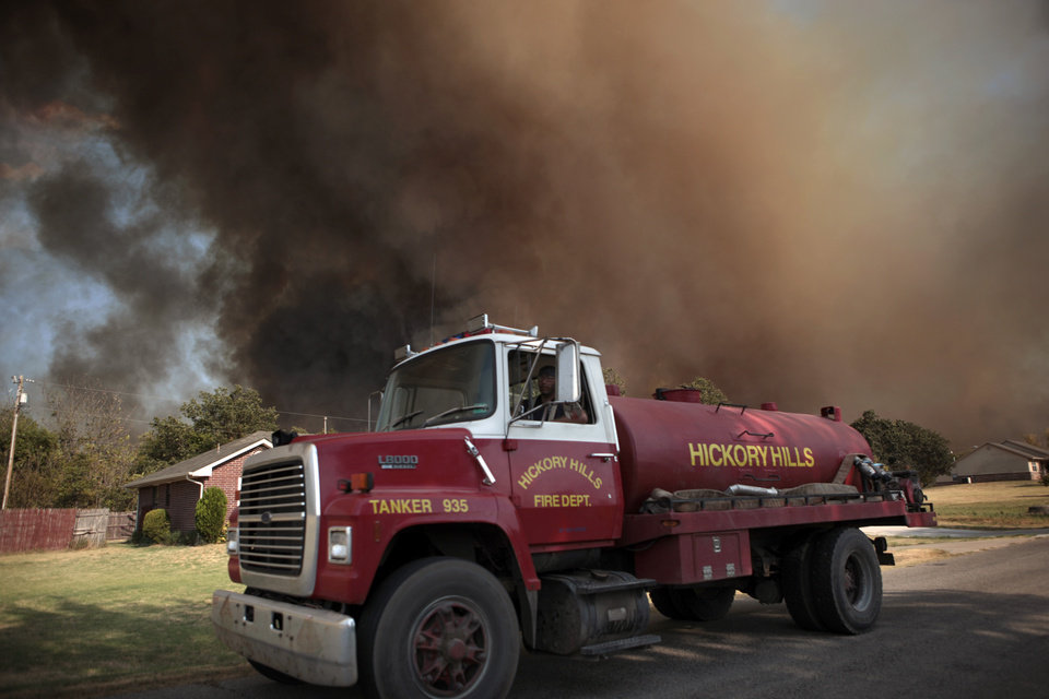 A Hickory Hills tanker works in Luther, Okla., during a large wildfire Friday, Aug. 3, 2012. Photo by Sarah Phipps, The Oklahoman
