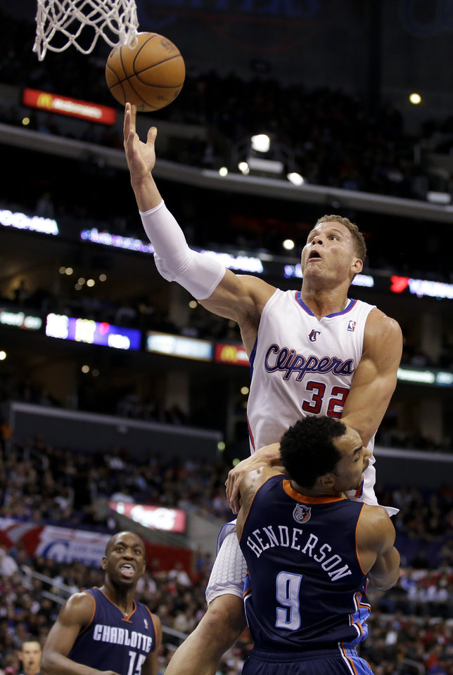 Los Angeles Clippers forward Blake Griffin (32) goes to the basket over Charlotte Bobcats guard Gerald Henderson (9) during the first half of an NBA basketball game in Los Angeles, Tuesday, Feb. 26, 2013. (AP Photo/Chris Carlson)