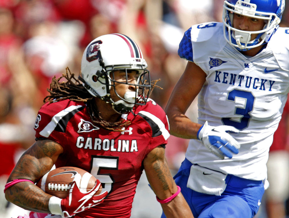 FOR USE AS DESIRED WITH NFL DRAFT STORIES - FILE - In this Oct. 8, 2011, file photo, South Carolina cornerback Stephon Gilmore (5) looks upfield in front of Kentucky wide receiver Matt Roark (3) after an interception during the first quarter in an NCAA college football game at Williams Brice Stadium in Columbia, S.C. Gilmore is a top prospect in the upcoming NFL football draft. (AP Photo/Rich Glickstein, File)