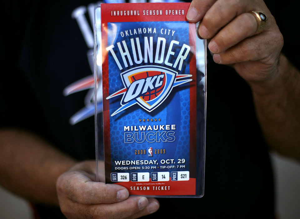 "OKLAHOMA CITY THUNDER / NBA BASKETBALL TEAM / REGULAR SEASON OPENING NIGHT / CHARLES SCHMITT: Charles ""Smitty"" Schmitt holds up his season ticket outside the Ford Center in downtown Oklahoma City on Wednesday, October 29, 2008. By John Clanton, The Oklahoman  ORG XMIT: KOD"