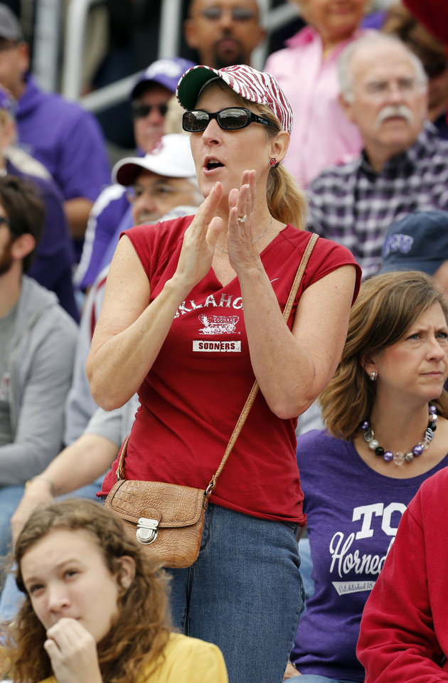 Photo - Sooner graduate and fan Kristie Johnson, Fort Worth, cheers during the college football game between the University of Oklahoma Sooners (OU) and the Texas Christian University Horned Frogs (TCU) at Amon G. Carter Stadium in Fort Worth, Texas, on Saturday, Dec. 1, 2012. Photo by Steve Sisney, The Oklahoman