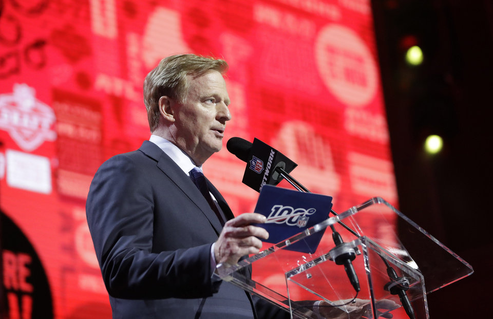 Photo - NFL Commissioner Roger Goodell announces Washington's Kaleb McGary has been selected by the Atlanta Falcons in the first round at the NFL football draft, Thursday, April 25, 2019, in Nashville, Tenn. (AP Photo/Mark Humphrey)