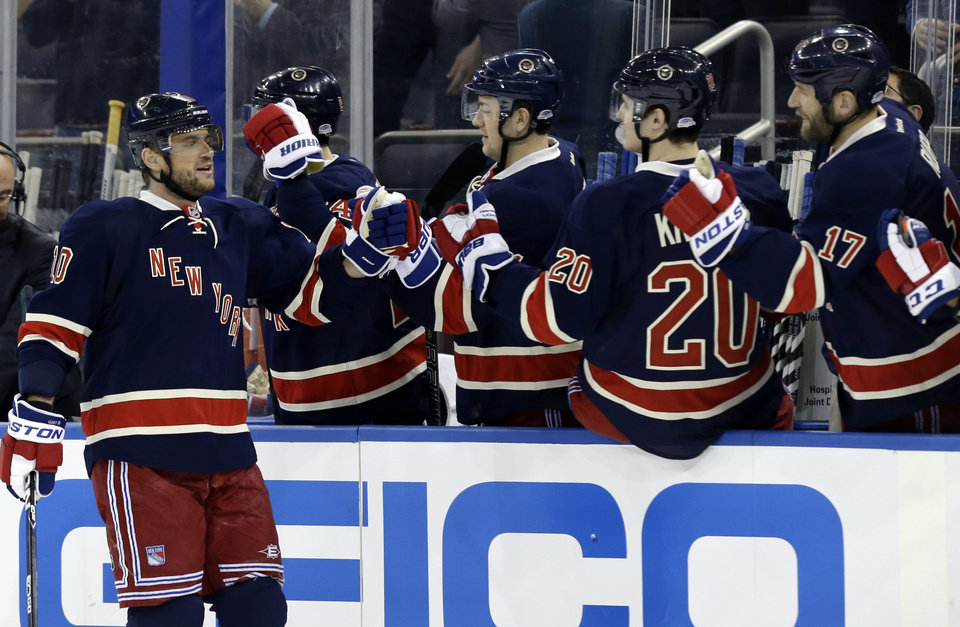 New York Rangers right wing Marian Gaborik (10) celebrates with teammates after he scored one of two goals in the first period of their NHL hockey game at Madison Square Garden in New York, Wednesday, Jan. 23, 2013. (AP Photo/Kathy Willens)