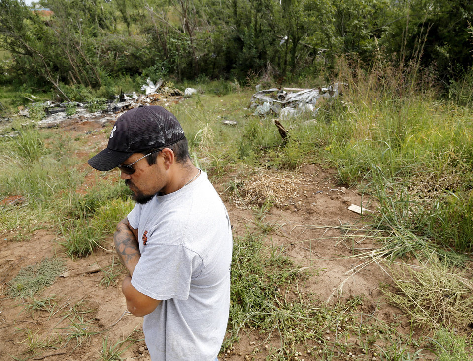 Photo - Jeremy Knox at his Carney home/business, which were  destroyed in the May 19 tornado. Knox also is on the temporary high risk pool for health insurance due to a serious pre-existing health condition.  Photo  by Jim Beckel, The Oklahoman.